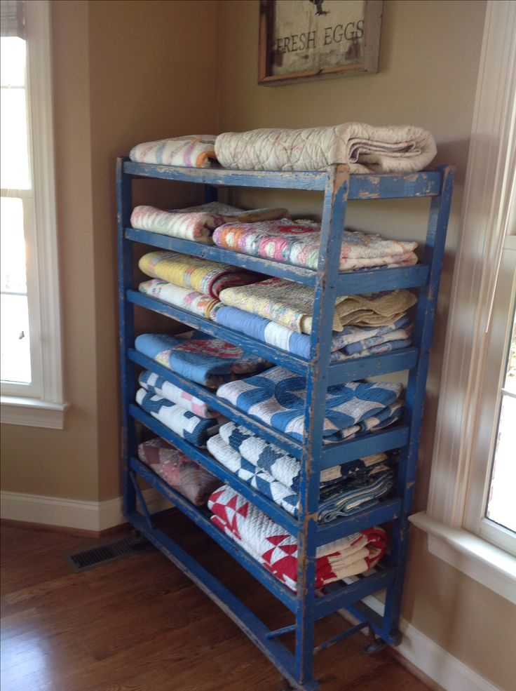 Found this antique shoe rack in the best French blue color...switched out my other one for this one... Love my quilts displayed here.