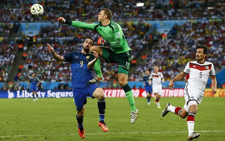 Germany's Manuel Neuer punches the ball clear under pressure from Argentina's Gonzalo Higuain Photo: Jason Cairnduff/Action Images | 2014 World Cup Final