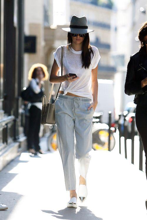 Kendall Jenner en baskets Miu Miu, chapeau Rag &Bone et sac Céline à Paris en juillet 2015