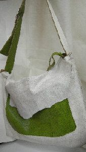 distressed white calf hide messager bag with green pockets