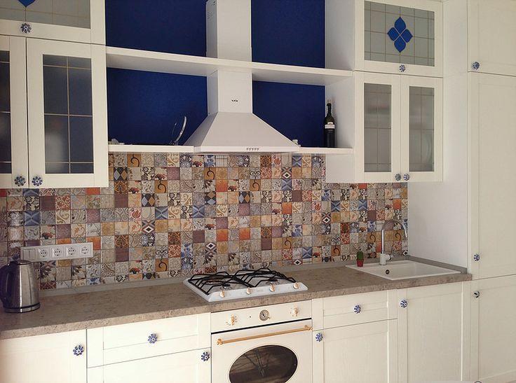 white traditional kitchen with ceramic blee handles and blue vitrage #SMIRNOVAINTERIORSPARIS