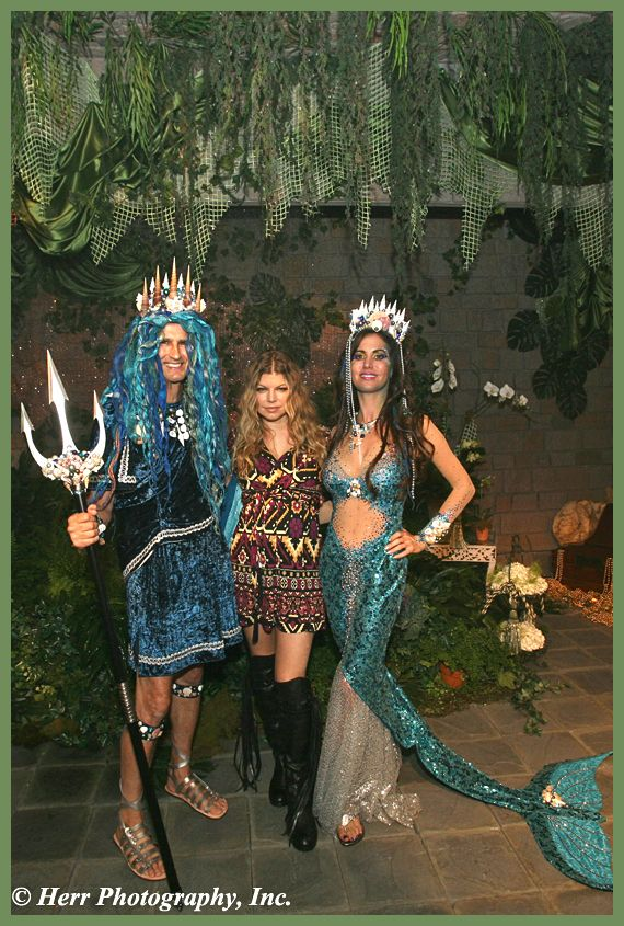 Tanya Brandes in a custom mermaid outfit from Paris, with husband, 'King Neptune' Charles Brandes, and Fergie Fergilicious!
