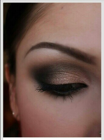 """You can never go wrong with a neutral, smokey eye. Check out our """"Celebrity-Inspired Wedding Hair, Makeup and Dresses"""" blog for more trendy wedding looks!"""