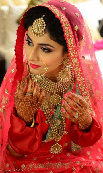 Bridal Portrait - Soft Pink Makeup with Gold jewelry | WedMeGood | Pink Bridal Lehenga with Antique Gold Necklace, Maang Tikka, Earrings and Nath, Mehendi Hands #wedmegood #indianbride #sikhbride #indianwedding #jewelry #portrait #pink #lehenga #mehendi