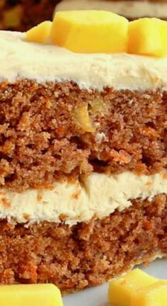 Mango Ginger Carrot Cake with Candied Ginger Cream Cheese Frosting ~ A delicious new twist on this dessert cake classic with a spiced ginger twist to the cream cheese frosting that you'll love too.