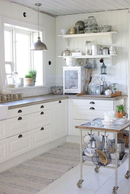 polished wood bench, white cupboards, shell handles <3