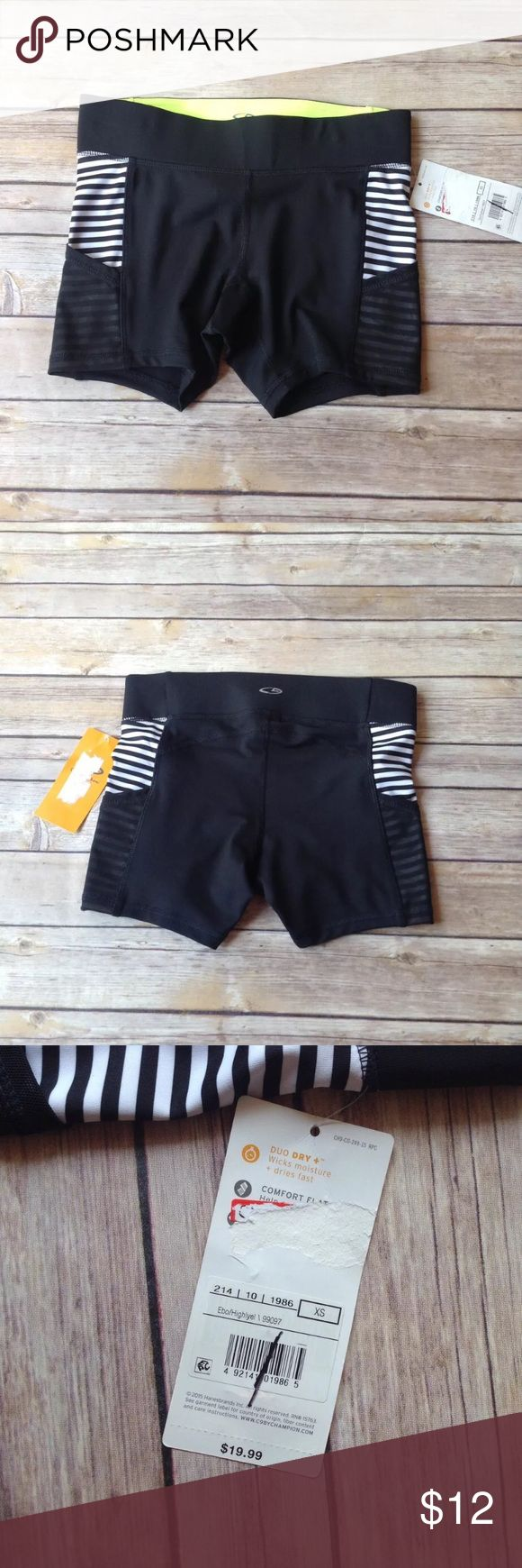 """C9 by Champion black and white compression shorts New with tags C9 by Champion women's size XS black and white compression shorts with mesh side pockets. Excellent condition. No rips holes or stains. 87% polyester 13% spandex. Retail $19.99.  Measurements: Length- 11"""" Waist- 25""""- 28"""" Inseam- 4""""  I ship fast! Pay before 4:30pm Monday thru Friday and I will ship the same day! Thank you for looking! Check out my other items! Champion Shorts"""