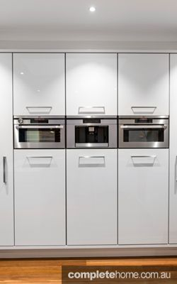 Modern kitchen design, incorporating appliances into these spaces, from Enigma Interiors