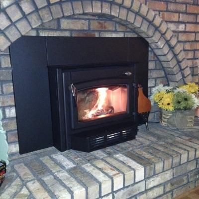 Good looking installation. High efficiency wood stove fireplace insert