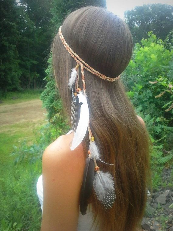 Elegant Native American Style Feather Headband ----------------------------------------------  Black, white, striped and spotted feathers drape down from a tan woven faux suede headband adorned with wooden beading.  Can be wrapped once or twice ...