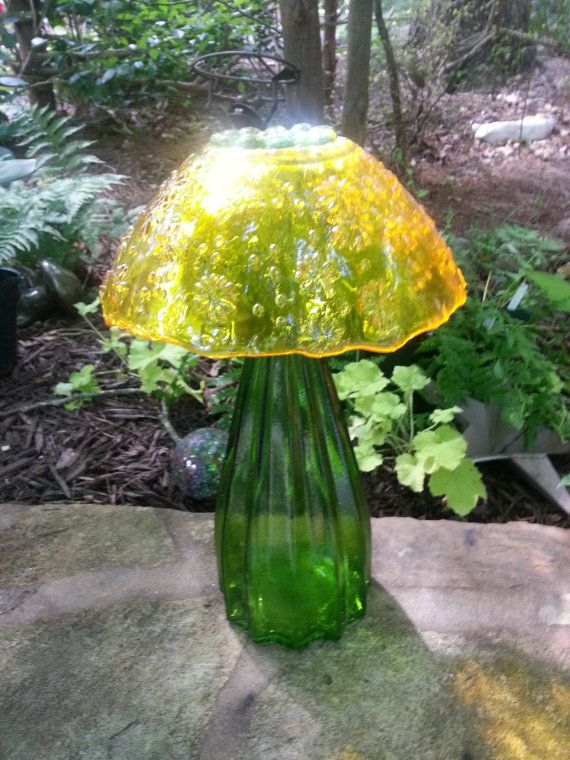 Sparkly Glass Garden Mushroom via Etsy.....I think I could make these with some yard sale finds!!!!