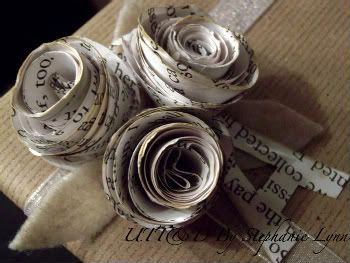 paper rosettes using old book pages - could use glimmer mist, ink