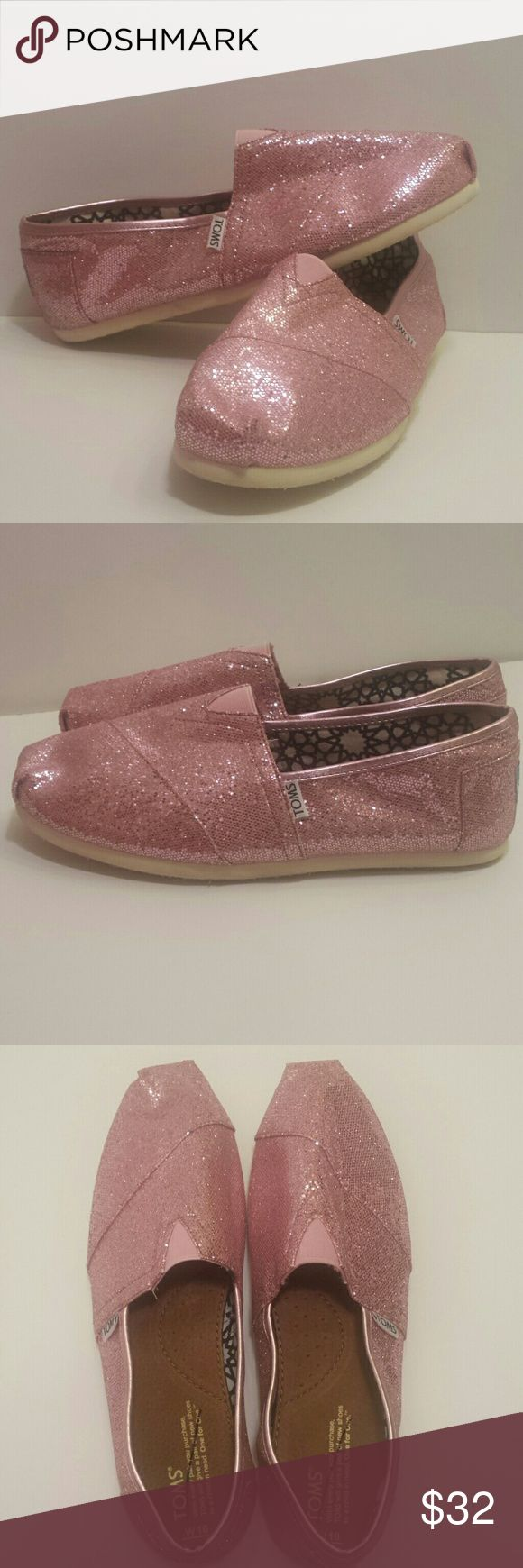 TOMS NWOT pink glitter original TOMS sparkly shoes NEW WITHOUT TAGS.   Tom's pink glitter shoes. These shoes are amazing, because glitter makes everything better. These shoes are in new without tags condition. They were purchased at a TOMS sale so there is a black slash through the logo on the inside...but you're going to wear them all the time so nobody will ever know. 😉  Women's size 10 TOMS Shoes Flats & Loafers