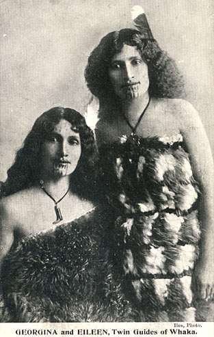 """An old postcard with two ladies from New Zealand. The caption reads, """"GEORGINA and EILEEN, Twin Guides of Whaka."""""""