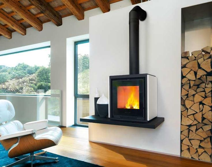 QUBE 1 This compact stove is well suited for smaller spaces. Fine hand-made majolica cladding. Optional majolica bench.  www.calore.co.za