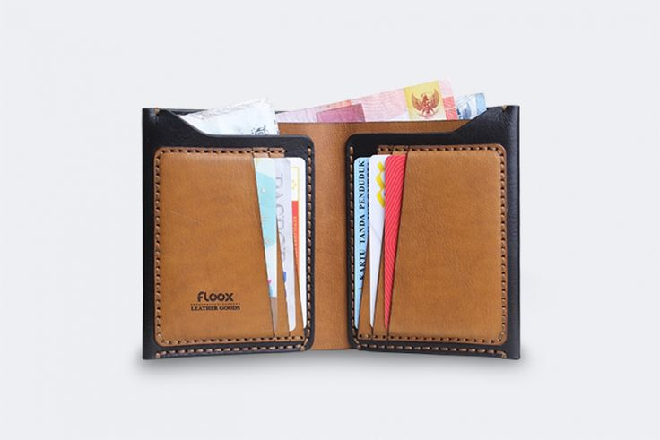 Designed with modern concept and classic touch in completion process, it's the perfect choice to accompany your daily activity.  - Short bifold wallet - Available in 3 colors : 1. Brown 2. Duotone (Black and brown) 3. Full Black - Full grain vegetable tanned cowhide leather - Hand stitched using polyester waxed thread - Floox logo laser engraved	 - 1 cash slot, 6 card slots, 2 hidden slots - Dimension 9.5 cm x 12 cm x 1.5 cm (closed) - Finished edge and back of leather