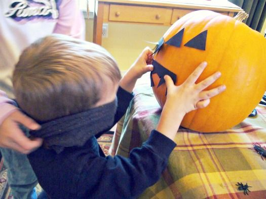 This is a cute idea for a halloween party. The teacher would provide the pumpkin. You cut out triangles for eyes, a mouth and a nose. The children can pick what they want to pin on the pumpkin. Children would be blindfold and spin  three times. Then lead them straight to the pumpkin and they will pin the body part they choose. the closest  wins a price.