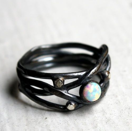 Opal ring. I very much like this. It'd be even better if it were a dragon's breath opal, though.