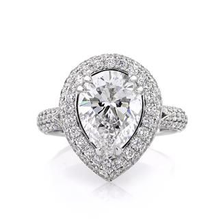 4.45 carat pear shaped diamond engagement ring with halo. Although I'd like the halo to have some color because it really highlights the diamond.