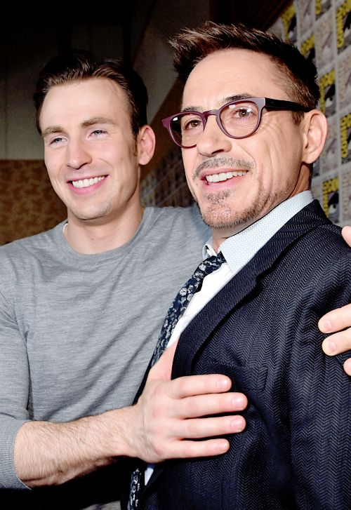 Chris Evans and Robert Downey Jr. attend Marvel's Hall H Press Line for 'Ant-Man' and 'Avengers: Age Of Ultron' during Comic-Con International 2014 at San Diego