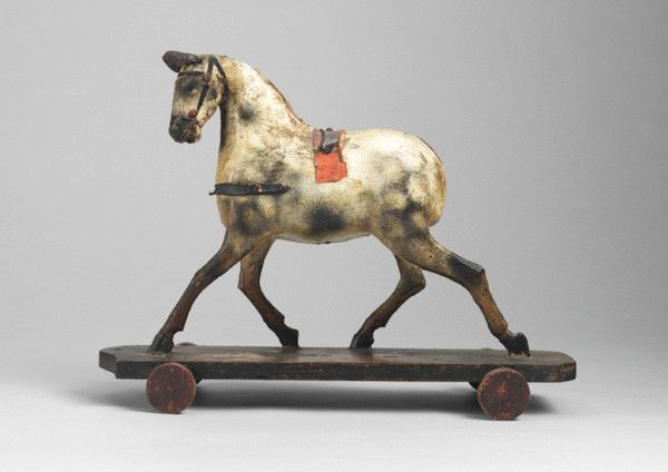Running Horse Pull Toy...hand carved and patinated wood and papier mache, with leather ears & harness details, English, c.1870.