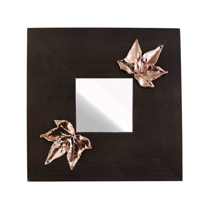 Wooden mirror with two ivy leaves, in shiny copper. The drawing and engraving in wax is made by the artist Marios Voutsinas. Dimensions: 25 cm x 25 cm x 1 cm  Copper.