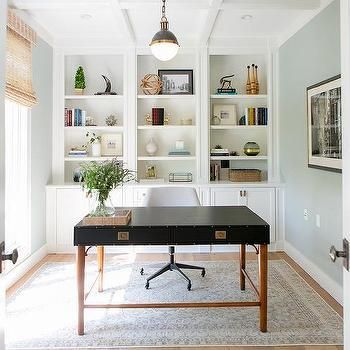 Traditional home office with built-in bookcases, sleek black desk, white rolling chair, coffered ceilings and natural lighting | Braun Adams #Traditionalhomeoffices