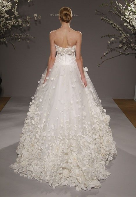 A wedding dress that looks like it's made of flower petals