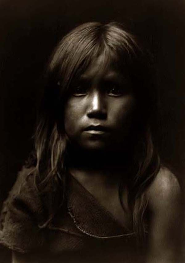 Here we present an historic image of Hopi Angel, a small girl. It was taken in 1905 by Edward S. Curtis.    The image shows the Hopi girl in a head-and-shoulders portrait, facing front.    We have created this collection of images primarily to serve as an easy to access educational tool. Contact curator@old-picture.com.