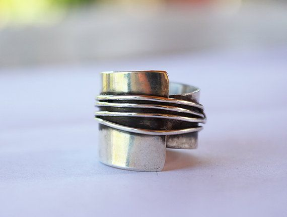 Its a beactiful asymmetrical ring, a bit chunky,one of a kind This ring was created by sterling silver  dimentions :2cm in one side and 1 cm in the
