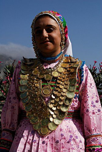 A woman wearing traditional Kolaina (golden coins necklace) Karpathos, Olymbos