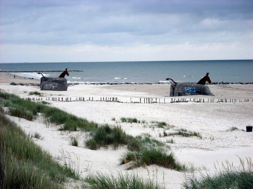 Blåvand Strand in Denmark. Horses made from old German bunkers from the 2. World War.