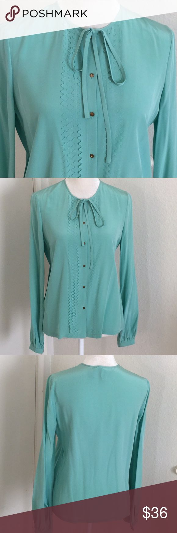 Diane Von Furstenberg Silk Mint Blouse Timeless and Feminine  100% Silk Stain Bottom Hem in the Black  (please look at picture) Price Reflect due to this Overall no other Flaws, Excellent Condition   Been Dry Cleaned Diane Von Furstenberg Tops Blouses