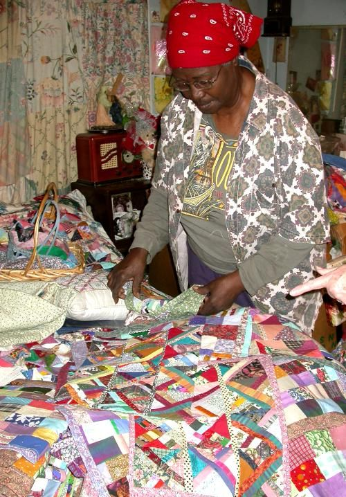 Ms Anna Williams quilter from Baton Rouge LA using her bed as her layout table.