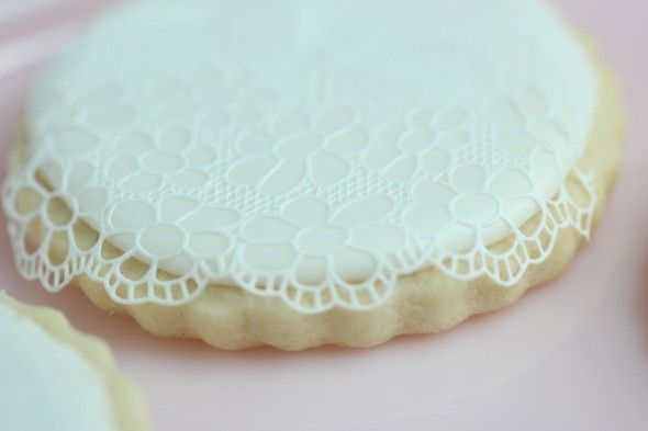 SugarVeil is a confectionery icing which is like any royal icing; it can be piped, or used to flood cookies etc., but the absolutely unique (and amazing!) thing about it, is that its actually flexible and pliable while its drying, so that it can be manipulated into shapes just like a fabric would, for example.