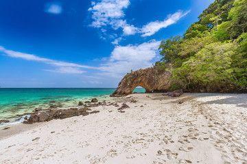 Stone with beautiful beach and blue sky at Koh Koh hin-ngam in Andaman Sea near Koh Lipe,Tarutao national park and Koh Lipe Satun Province Thailand