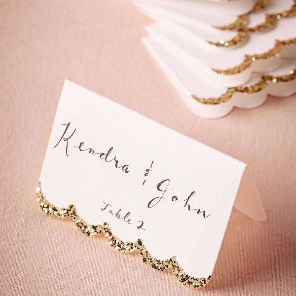 My Wedding: 12 Pretty Picks for Your White & Gold Wedding. Gold scalloped place card.