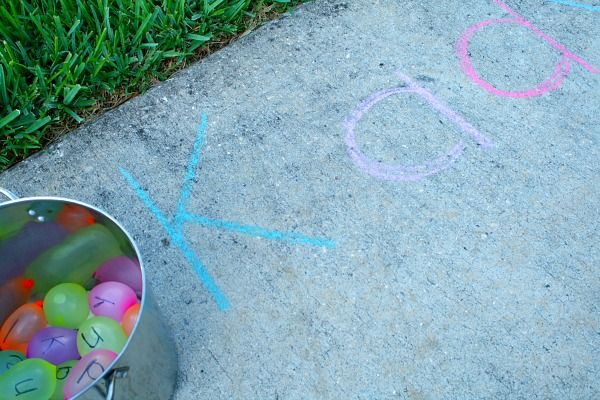 Water Balloon Name Game:  Find a ballon with the letter on it and smash it on the matching chalk letter.  FUN! #homeschool