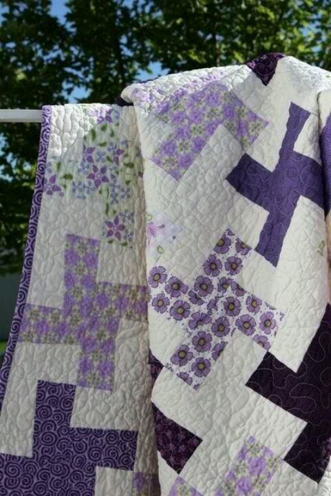 Purple and white Windmill quilt. See a tutorial on how to sew Windmill blocks at QuiltersDiary.com. Good wedding quilt for grand daughter