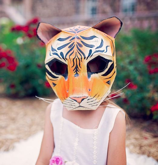 Tiger Mask Once you've built and shaped the mask, get creative in painting your design. Add some extra details such as whiskers made using pipe cleaners. (Photo: Wintercroft)