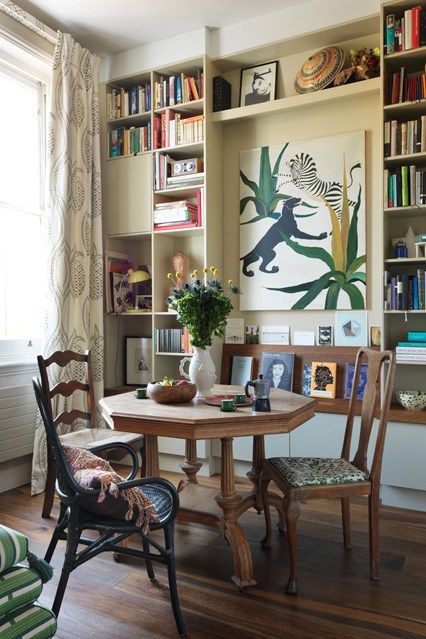 Floor to ceiling bookshelves add visual impact in tis small sitting room. http://www.houseandgarden.co.uk/interiors/bookshelf-ideas-living-room-study-design/floor-to-ceiling-bookshelves-beata-heuman?next#ViewImage