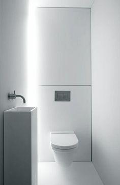 Beautiful white bathroom by Govaert & Vanhoutte Architects.