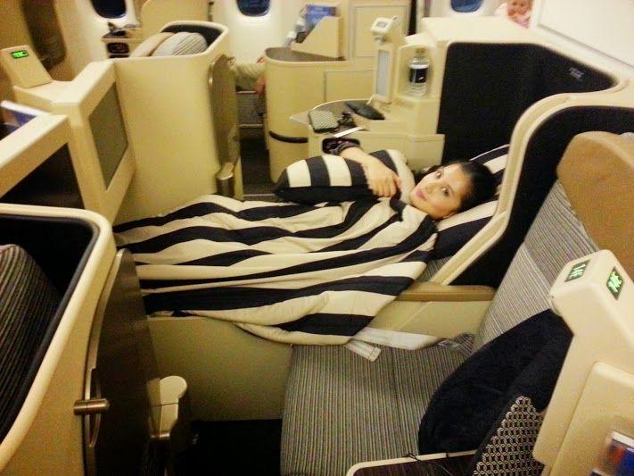 Etihad business class seat lies fully flat. Abu Dhabi to London