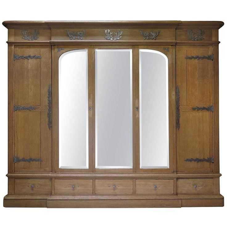 Solid Oak Wardrobe with Olive Leaf Motif Hardware, France, Early 1900s | From a unique collection of antique and modern wardrobes and armoires at https://www.1stdibs.com/furniture/storage-case-pieces/wardrobes-armoires/