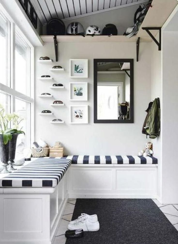 In a nautical-style entryway, that ledge space is ideal for accessories that look better shelved than in a box.