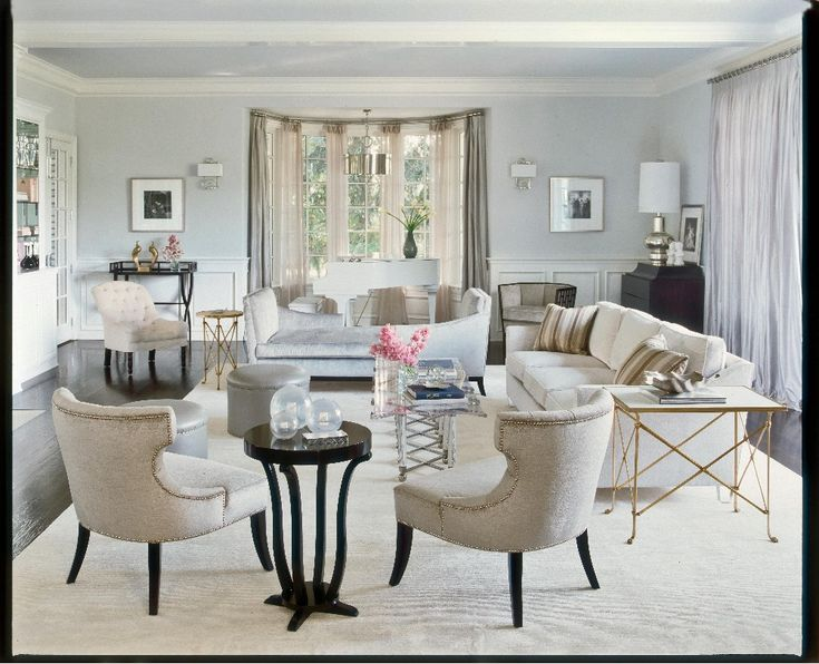 J Lo! Her California home was designed by Michelle Workman and it is so incredibly dreamy! Just look how peaceful her living room is with all the gray-blues-