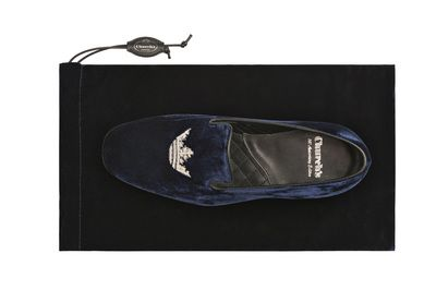 """2013/ To celebrate its 140th Anniversary, Church's has created a 'Limited Edition' style of the iconic """"Crown Sovereign"""", available in both men's and women's versions, and made of Royal Blue velvet with silver thread embroidery, that highlights the classic crown on the front. Each piece has been customised by hand from numbers 1 to 800 and presented in a special packaging."""