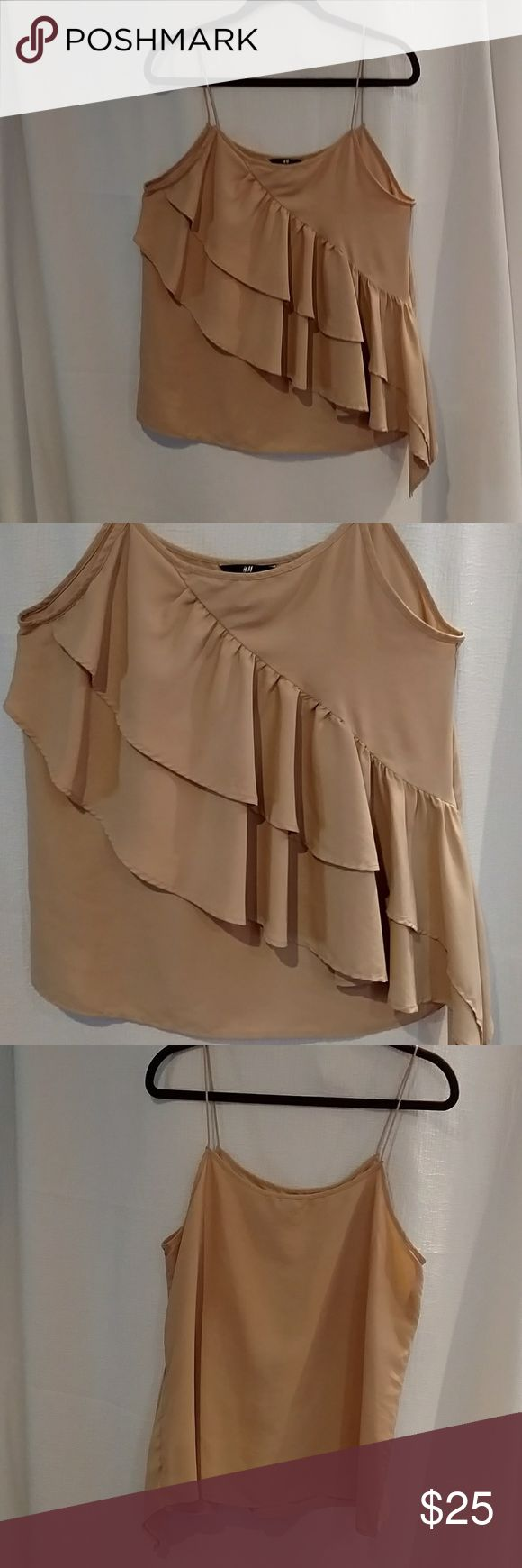 NWOT H&M Front Ruffle Cami Style Top Size 14 Lovely soft beige cami top, smooth back and cascading ruffles on the front. Perfect for year around. In the cooler weather pair it with a jacket or more casual with a cardigan. Great staple in your wardrobe! H & M Tops