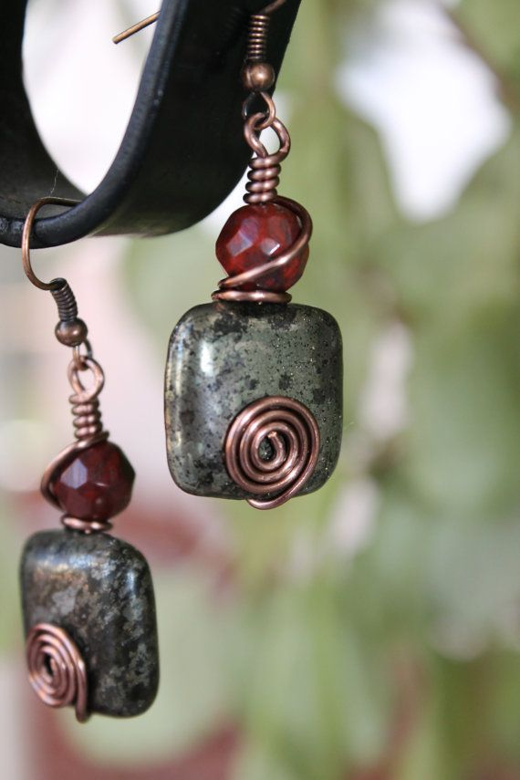 These pretty pair of handmade earrings are securely attached by non tarnish Antique Copper wire wrapped around the beautiful rustic color beads.  This earring hang 1.50 inch from the bottom of the ear hoop.    Thanks for looking.