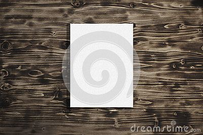 Empty canvas frame on a wooden background. Mock up poster.